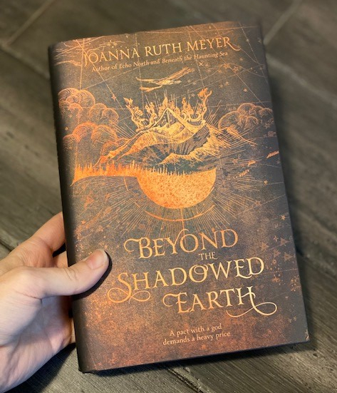 MLC CO January Unboxing Beyond the Shadowed Earth Book